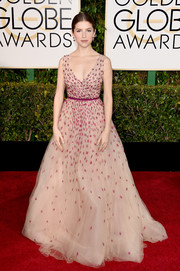 Anna Kendrick looked downright enchanting at the Golden Globes in a delicately beaded blush-colored princess gown by Monique Lhuillier.