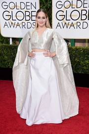 Jemima Kirke's long white skirt and caped silver top looked like something out of Padme Amidala's closet.