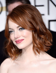 Emma Stone looked darling with her short wavy 'do at the Golden Globes.
