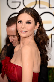 Catherine Zeta Jones left her hair down in a tumble of curls during the Golden Globes.