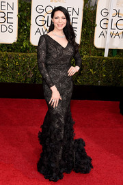 Laura Prepon donned a black Christian Siriano gown, boasting plenty of flirty flourish with its swirly embroidery and ruffled hem, for the Golden Globes.