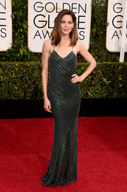 Michelle Monaghan looked alluring at the Golden Globes in a clingy forest-green Jason Wu gown rendered in silver beads.