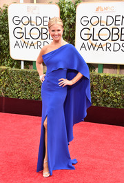Nancy O'Dell looked quite the diva in an electric-blue Angel Sanchez one-shoulder gown, featuring a fluttery cape and a thigh-high slit, at the Golden Globes.