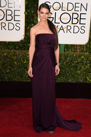 Katie Holmes looked very polished and elegant at the Golden Globes in a plum-colored strapless gown by Marchesa.