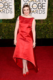 Lena Dunham was at her elegant best in a sleeveless red high-low dress by Zac Posen at the Golden Globes.