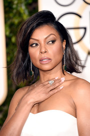 Taraji P. Henson topped off her look with a teased bob.