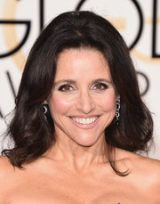 Julia Louis-Dreyfus sported a toned-down bouffant at the Golden Globes.