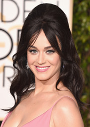 Katy Perry kept up the retro vibe of her beehive hairstyle with retro cat eyes and matte pink lipstick.