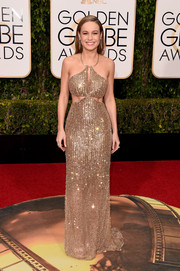 Brie Larson was a style standout at the Golden Globes in a crystal-embellished cutout gown by Calvin Klein.