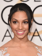 Miss Golden Globes Corinne Foxx looked radiant with her pale pink lips, mile-long eyelashes, and luminous skin.