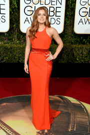 For the Golden Globes, Amy Adams donned a red-orange Atelier Versace column dress with beading along the waistline and down the side.