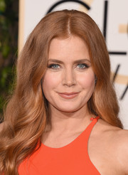 Amy Adams wisely paired her bright orange gown with nude lips and subtle eye makeup.