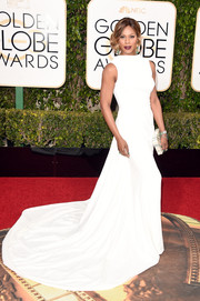 Laverne Cox made a grand entrance in a white Elizabeth Kennedy gown with a long train during the Golden Globes.