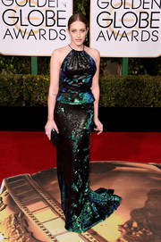 Carly Chaikin brought a unique sparkle to the Golden Globes red carpet with this fully sequined halter gown by Juan Carlos Obando.