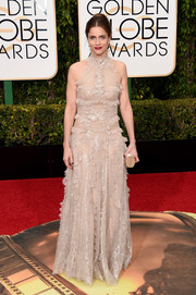Amanda Peet opted for a shimmery nude lace gown by Alexander McQueen for her Golden Globes look.