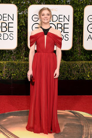 Natalie Dormer was modern and chic at the Golden Globes in a red J. Mendel gown with a keyhole cutout and exposed shoulders.