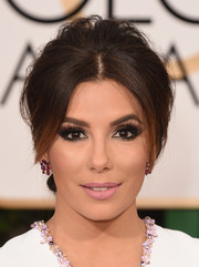 Longoria finished off her glam look with pale pink matte lipstick.