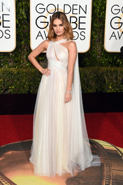 Lily James looked heavenly at the Golden Globes in an asymmetrical white Marchesa gown with peekaboo detailing.