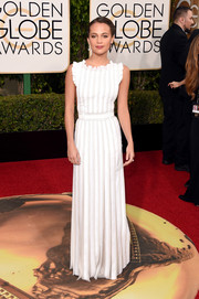 Alicia Vikander charmed in a pleated and ruffled white gown by Louis Vuitton at the Golden Globes.