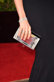 Sophia Bush carried a metallic silver clutch to complement her dazzling jewelry at the 2016 Golden Globes Awards.