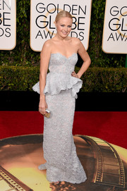 Malin Akerman dazzled in an embroidered silver peplum gown by Reem Acra at the Golden Globes.