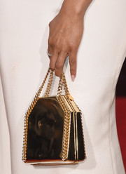 Taraji P. Henson had a chic look with her gold chain clutch that featured brown and green hued prints at the 2016 Golden Globes Awards.