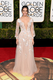 Even with that cleavage-baring neckline, Corinne Foxx's bird-embroidered gown at the Golden Globes still looked very classy!