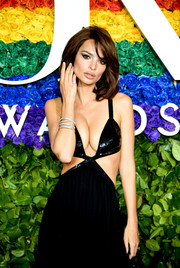Emily Ratajkowski teamed stacks of silver bangles with her sexy gown at the 2019 Tony Awards.