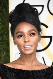 Janelle Monae attended the Golden Globes rocking a pearl-studded beehive.