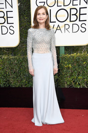 Isabelle Huppert made an elegant arrival at the Golden Globes in a pale-blue beaded-bodice gown.