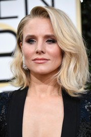 Kristen Bell worked a voluminous teased hairstyle at the Golden Globes.