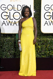 Viola Davis brought an elegant pop to the Golden Globes red carpet with this canary-yellow one-shoulder gown by Michael Kors.