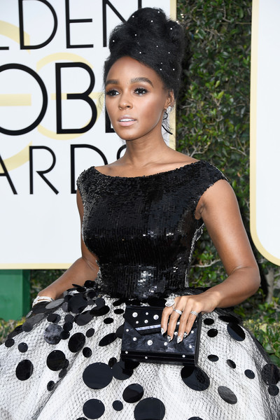 Janelle Monae accessorized with a polka-dot hard-case clutch by Jimmy Choo to match her cute gown at the Golden Globes.