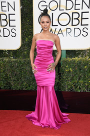 Karrueche Tran looked pageant-ready in a ruched hot-pink mermaid gown at the Golden Globes.