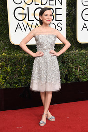 Millie Bobby Brown complemented her dress with a pair of silver evening sandals by Sophia Webster.
