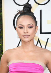 Karrueche Tran showed off a sculptural top knot at the Golden Globes.