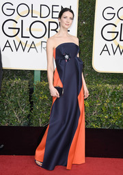 A black velvet clutch by Jimmy Choo polished off Caitriona Balfe's ensemble.
