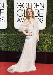 Drew Barrymore looked simply fab in a plunging white cutout gown by Monique Lhuillier at the Golden Globes.