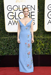 Jessica Chastain looked picture-perfect at the Golden Globes in a low-cut periwinkle-blue Prada gown with colorful beading cascading down one side.