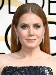 Amy Adams gave her simple 'do a glamorous punch with a pair of diamond chandelier earrings by Cartier.