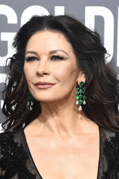 Catherine Zeta-Jones was rocker-glam with her teased waves at the 2018 Golden Globes.