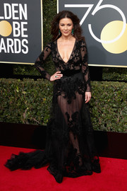 Catherine Zeta-Jones made eyes pop with this sheer, plunging black gown by Zuhair Murad Couture at the 2018 Golden Globes.