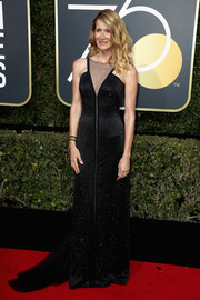 Laura Dern sheathed her figure in a black Armani Prive gown with a sheer neckline and a cascading train for the 2018 Golden Globes.