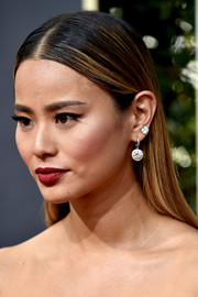 Jamie Chung teamed a diamond stud with a matching dangling earring for her Golden Globes bling.