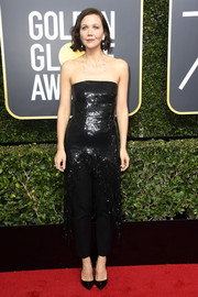 Maggie Gyllenhaal donned a Monse strapless sequin dress with a fringed high-low hem for the 2018 Golden Globes.