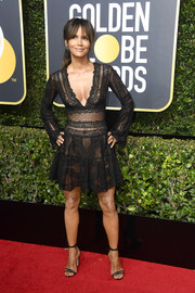 Halle Berry worked her ageless figure in a sheer black lace dress by Zuhair Murad at the 2018 Golden Globes.
