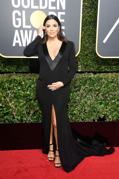 Eva Longoria completed her red carpet attire with a pair of black multi-strap sandals by Saint Laurent.