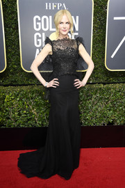 Nicole Kidman enchanted in a black lace-bodice gown by Givenchy Couture at the 2018 Golden Globes.