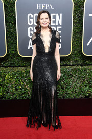 Geena Davis was all about flapper glamour in this fringed and sequined black gown by Monique Lhuillier at the 2018 Golden Globes.