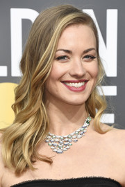 Yvonne Strahovski paired her strapless gown with a diamond chandelier necklace by Bulgari.